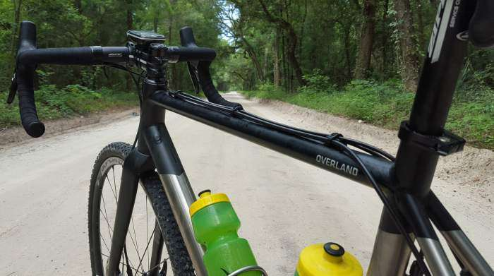 One of the final dirt roads. Top tube glistening...