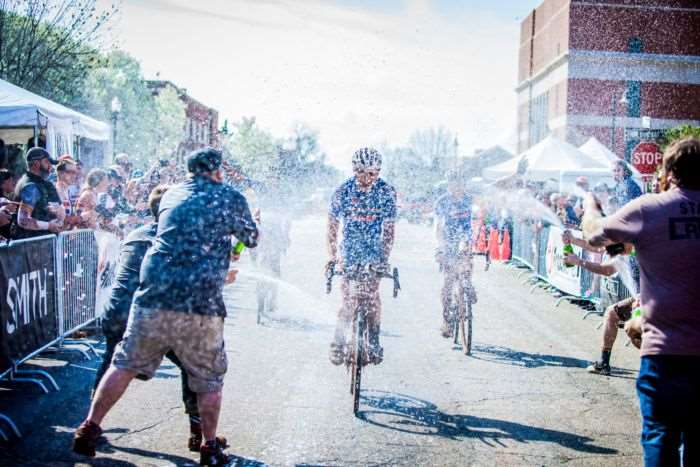 Champagne mixes with the dirt of Land Run 100.