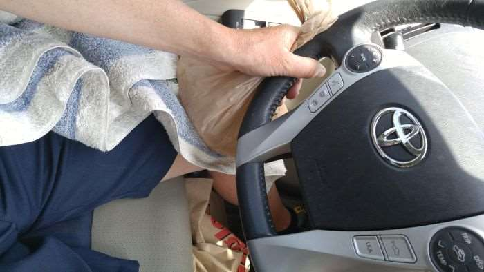 JOM driving with fancy icebag setup on knee.
