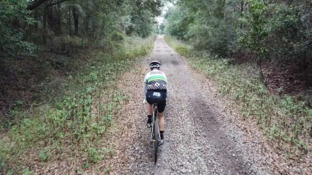 riding a bicycle on a disused railway line